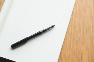 Desk-notebook-pen-writing-large