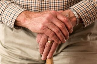 Hands-walking-stick-elderly-old-person-large